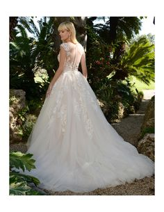 Walk once upon dream in this lace ballgown available at Spotlight Formal Wear! #SpotlightBridal