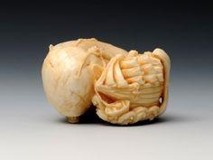 A white whale   (2010)  Material:Whale teeth · Coral · Tortoiseshell  4.5 × 4.0 × 2.8 cm