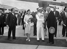 President Dwight Eisenhower gives a welcoming hand to  King Bhumibol Adulyadej at Washington National Airport, June 28,1960 as the American born head of Thailand and his Queen arrive for a five-day state visit