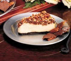 Turtle cheesecake=Luscious caramel cheesecake with toasted pecans, rich caramel, and bittersweet chocolate chips sitting on a chocolate cookie crust.  *Available at participating locations.