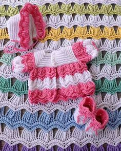 """Original Design By: Maggie Weldon Intermediate Skill Sizes: Outfit - To fit 3-6 and 6-12 months. Afghan – About 40"""" wide and 48"""" lon..."""