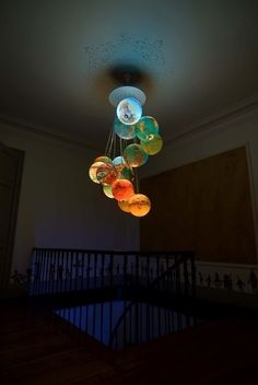A Father created this amazing chandelier for his son's bedroom out of old globes.