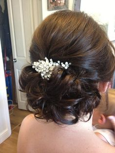 Bridal hair by Sarah Roberts. Lots of hight and low pinned curls. Jewelled bridal comb with vintage elements and Swarovski pearls and crystals by Bespoke Tiaras by Sarah Roberts.
