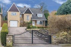 6 bedroom detached house. It looks very pretty and the gate is lovely too.
