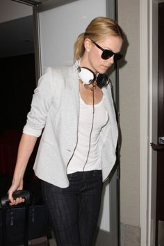 Charlize Theron arriving at the airport with her Skullcandy white Aviator Headphones