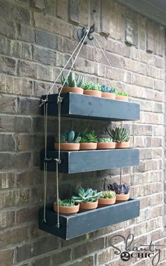 Build this DIY Hanging Planter to add warmth and life to your outdoor space! Also a fun piece to bring indoors! Free plans and how-to video at DIY Outdoor Wall Planter, DIY Planter, DIY Wall Planter, Hanging Planter DIY, Hanging Planter with Rope Creative Wall Decor, Creative Walls, Diy Hanging Planter, Pallet Planter Box, Outdoor Walls, Outdoor Wall Planters, Garden Planters, Wood Projects, Diy Furniture