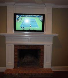 Hidden tv on pinterest for Motorized tv mount over fireplace