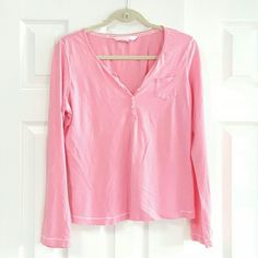 Victoria's Secret Long Sleeve Sleep Shirt .100% cotton with 5 button front  Hem is missing some stitching in front but hem has been repaired with bonding tape  see picture 4  gently worn and cleaned.  Still a lot of love left Victoria's Secret Tops Tees - Long Sleeve