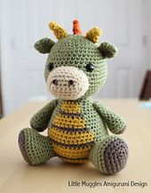 This is SUCH an adorable dragon! I love the scales on his back...(pattern available if you click photo)