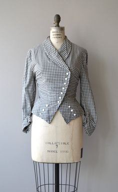Vintage 1950s light grey cotton and white check fitted jacket with open collar, asymmetrical white buttons, detail buttons and cuffed sleeves. --- M E A S U R E M E N T S --- fits like: medium shoulder: 15 bust: 34-36 waist: 27-28 length: 21 brand/maker: n/a condition: excellent ➸ More vintage coats http://www.etsy.com/shop/DearGolden?section_id=5800175 ➸ Visit the shop http://www.DearGolden.etsy.com _____________________ ➸ instagram | deargold...