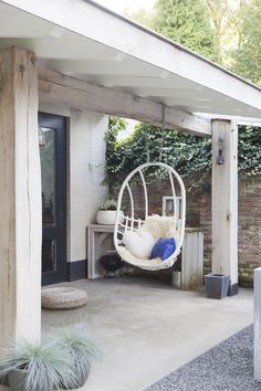 Simple patio/porch but love the simple environment, the coziness, would love to spend hours on that hanging chair to read books