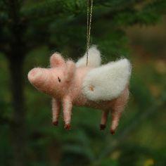 I definitely NEEEEEED a flying pig christmas ornament.