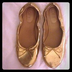 Gold Flat Gold flats with tiny bow.    *Welcome to my closet!  *Thanks so much for your likes and shares! I strive to share back! *Request bundles!  *Make offers!  *Do not ask lowest price.  *Sorry no trades or Paypal! Stop asking! It's against PM rules!  LOFT Shoes