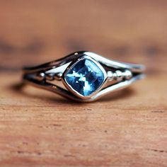 Blue topaz solitaire gemstone ring in recycled sterling silver. Perfect gift.