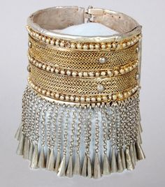 Africa | Woman's anklet,Yïgïr Ambar, made of silver and silver gilt from Ethiopia | These type of anklets were worn exclusively by high ranking Christian women. Gold or gilded silver could only be worn with the permission of the Emperor. Most gold was locally sourced, but much of the silver was obtained by melting down imported Maria Theresa Thalers.  The small conical bells, commonly found on Christian Ethiopian jewellery. | ca. 19th century, prior to 1868.