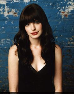 Seriously thinking about getting bangs ala Ann Hathaway in Devil Wears Prada. What do you think?