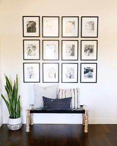 Black and white gallery wall with a matching wooden bench, chic up your hallway a la @kailawalls' monochrome setup   Get ready-to-shop #LTKhome details with www.LIKEtoKNOW.it   http://liketk.it/2pYAM #liketkit ⠀