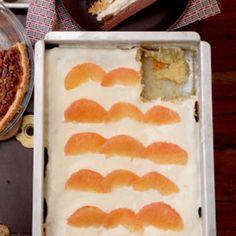 Grapefruit Cake by Saveur. This citrus-spiked sheet cake is a Texas potluck favorite. Grapefruit Cake, Grapefruit Recipes, Saveur Recipes, American Desserts, Sheet Cake Recipes, Brownie Cake, Sweet Cakes, Cake Plates, Dessert Bars