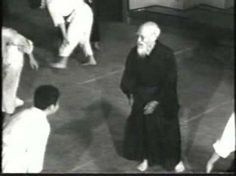 """""""Aikido - Morihei Ueshiba - Way of Harmony - 04"""" Video of O-Sensei, founder of Aikido, near the end of his life (1961, age 77).  Honolulu Aikikai Grand Opening. I love the randori scene. I also love that they show him working with women, and of course the weapons scenes."""