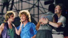 "allaboutjonesy: """"Paul Martinez, Robert Plant, Tony Thompson, and John Paul Jones after their set at Live Aid. July 13th, 1985. Photo by Amy Sancetta. "" """