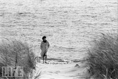 On the morning after her husband was elected the 35th President of the United States, as jubilant family members celebrated back at the Kennedy mansion, eight-months-pregnant Jackie steals a moment of privacy, going for a walk on the beach at Hyannis Port.