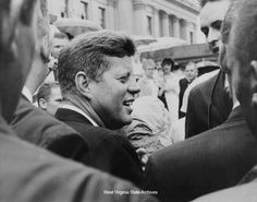 Photograph, President John F. Kennedy speaking to people outside the capitol at West Virginia's centennial celebration, June 20, 1963, Charleston. Photograph by Frank Wilkin, Charleston Gazette. Frank Wilkin Collection