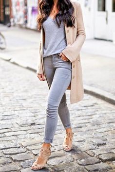 Chic casual neutral fashion, gray jeans and tshirt with long beige cardigan