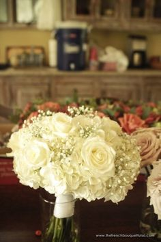 all-white bridal bouquet with sweet touches of Baby's Breath