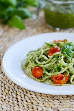 With fresh basil pesto, homegrown zucchini and tomatoes, this quick and easy zucchini pasta pesto is paleo, gluten-free, and dairy-free. | cookeatpaleo.com
