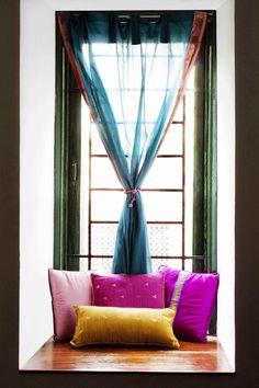 Karthik's home in Bangalore. Love the sari curtain & pillows!