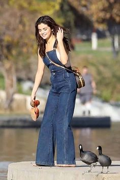 Selena Gomez wore a pair of Wrangler Denim Overalls with a Louis Vuitton bag while feeding the ducks. Get her look here! Denim Jumpsuit, Denim Overalls, Denim Jeans, Autumn Winter Fashion, Winter Style, Western Wear, Her Style, Selena Gomez, Teen Fashion
