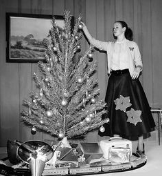 Aluminum tree, felt skirt, applique cardigan, color wheel, electric train... This picture just has it all!