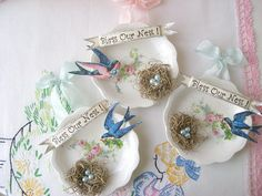 Small saucers create the perfect background for these shabby chic decorations. (by sweetnshabbyroses, via Flickr)