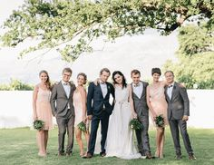 Love the way they coordinated the bridal party's colors. Bride and groom stand out, but everything works together and no one looks silly.