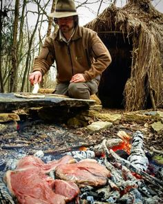 Mark at the primitive shelter cooking Johnny cakes on the hot rock and steak on the coals. A real palaeo dinner.  #outdoorcooking #outdoors  #primitivecooking #palaeo #palaeocooking #hotrockcooking  #openfirecooking #openfire #primitiveskills #primitive #bushcraft #bushcrafting #bushcraftcooking #stoneage #bushcraftskills #nature #primitiveshelter #outdoors #backtobasics #steak #johnnycake