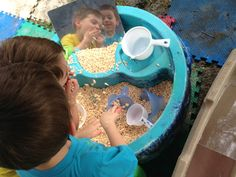 Water table fun. Don't worry you can always take a bath but you can't take away the memories