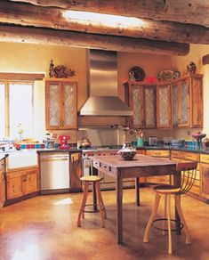 Southwestern kitchen with punched tin cabinet door. Love the turquoise and red backsplash. From Su Casa Southwestern Homes
