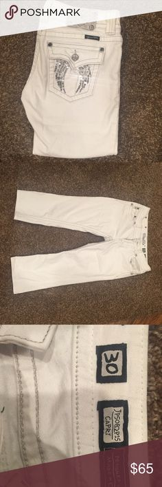 Miss me capris Size 30. White miss me jeans in excellent condition. Only have been worn a couple of times. They were always washed inside out and hung to dry. Paid $108 for them. I accept all reasonable offers. No holds or trades. I can go cheaper on m3rc@ri Miss Me Pants Capris
