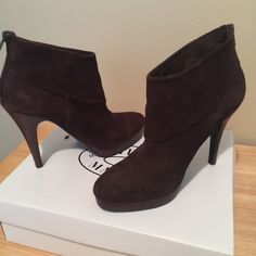 Steve Madden ankle boots with stiletto heel The are the coolest! They're a dark brown suede with wood platform and stiletto heel. They zip up the back so as not to take away from the subtle yet stunning look of the shoe itself. Worn twice so I know they're also very comfortable!!! Steve Madden Shoes Ankle Boots & Booties