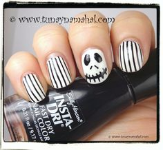 Jack Skellington nails. Sally Hansen insta-dri in Whirlwind White & Night Flight. Stamped with Messy Mansion Nail Art and Nail Parties plate MM06 for the stripes. Painted Jack Skellington with a nail art brush. #nightmarebeforechristmas #jackskellington