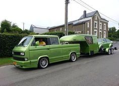 Cool rides, campers or iconic?  I just can't place the VW T2 with hotted up Jetta on toy hauler.  Awesome.