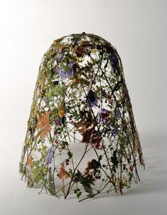 Delicate Vessels Sculpted with Pressed Flowers by Ignacio Canales Aracilby