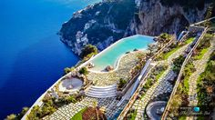 The infinity poolside terrace of the luxurious Monastero Santa Rosa Hotel and spa perched on the Cape d'Orso cliff face near Positano and Ravello on Southern Italy's beautiful Amalfi coast, offers one of the most enthralling and seductive panoramic vistas imaginable on the glorious Mediterranean coastline.