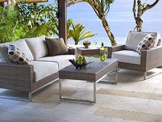 Palms sofa w/ cushions.  Rich, coffee colored wicker.  A clean, crisp look.