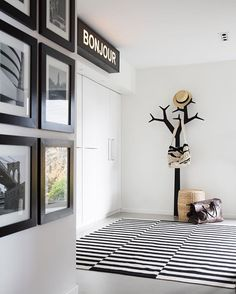Black and white entrance hall. I really had to think out of the 'box' on this one for the budget. DIY Bonjour light box and self framed prints from MoMA. Read more about this in the latest issue of @bonytt magazine. 📷 by @annemeranda_photo  #design #interiordesign #inspiration #bonytt #interiørmagasinet #interiormagazine #interior #interiør #blackandwhitephotography #blackandwhite #entrance #diy #lightbox #bonjour