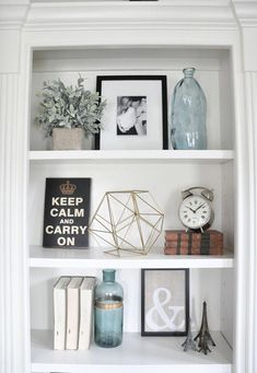 5 Simple Tips For Decorating Shelves Learn 5 simple tips to decorate your shelves with beautiful shelf decor ideas. Turn a knick knack shelf into a wall art display. Use these ideas for living room bookshelves, built ins to bathroom shelves. Styling Bookshelves, Bookshelves In Living Room, Decorating Bookshelves, Bookshelf Ideas, Bookcases, Dining Room Shelves, Bookshelf Inspiration, Book Shelves, Knick Knack Shelf