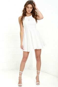 The Gal About Town Ivory Skater Dress is perfect for the busy girl who gets invited to everything! Textured stretch knit forms a sleeveless bodice with princess seams above a flirty skater skirt. A single gold button tops an open back. Hidden back zipper/hook clasp.