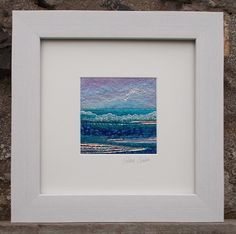 Seascape made with wet felt and needle felt techniques. The sky is made up of merino and silk fibres in sky blues with hints of lilac.