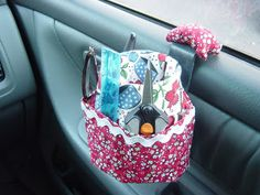 A. Maz. Ing. A sewing caddy for your car, including a thread catcher! Directions on how to make it.