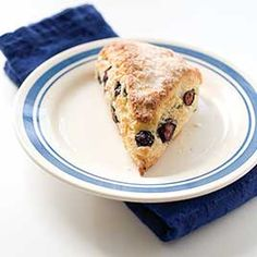 """Blueberry Scones - Cook's Illustrated """"For our ultimate blueberry scone recipe, we wanted to bring together the sweetness of a coffeehouse confection, the moist freshness of a muffin, the richness of clotted cream and jam, and the super-flaky crumb of a good biscuit. Increasing the amount of butter and adding enough sugar gave the scones sweetness without making them cloying; cutting frozen butter into the flour and giving the dough a few folds helped the scones rise; and rolling out the…"""